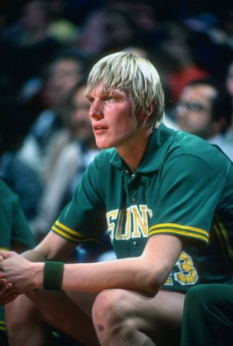 Jack Sikma of the Seattle Supersonics looks on from the bench against the Washington Bullets during an NBA basketball game circa 1977 at the Capital...: