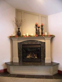 Love this look! Granite fireplace with step and mantle ...