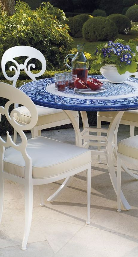 Our Italian Bacchus Hand-painted Dining Tabletop is crafted of fine, high-fired lava stone, which is harder than granite and naturally resistant to the elements.:
