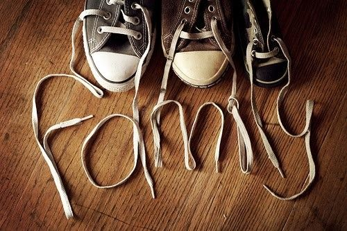 a different kind of family photo! line up a shoe from each person, and spell your last name, etc.: