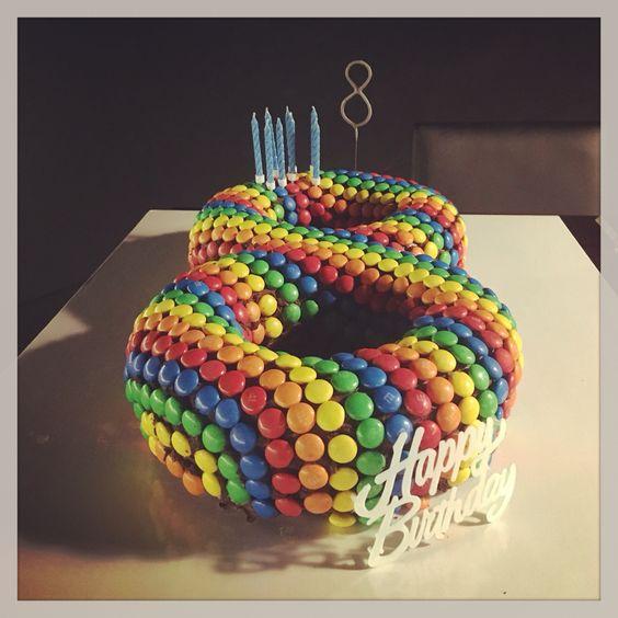Rainbow MMs birthday cake  8 years old  Trampoline