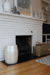 Painted fireplace hearth tile. Remove bricks and put down ...