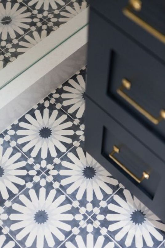 A Mobile Home Gets a Bohemian-Chic Makeover by Becky Harris | Houzz Handmade cement tile on the bathroom floor is a scene-stealer and gives the expected nautical style a big Moroccan twist. Floor tile: Eastern Promise in Tangier Pallazzo, 6¾ by 6¾ inches, by Martin Lawrence Bullard for Ann Sacks . Beach Style Bathroom by Holst Brothers General Contractors: