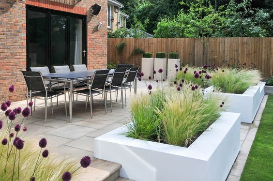 contemporary block planters filled with grasses and allium | Kate Thornton garden design,: