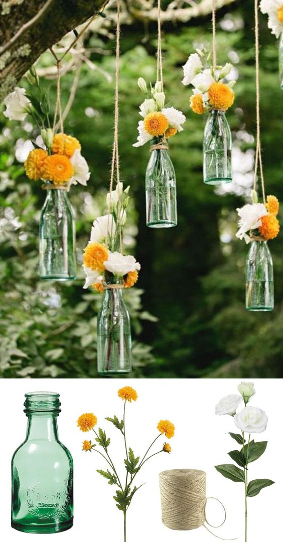 Easy and low cost wedding decorations! Make this beautiful hanging bottle display with silk flowers for your backyard or outdoor wedding! #diywedding: