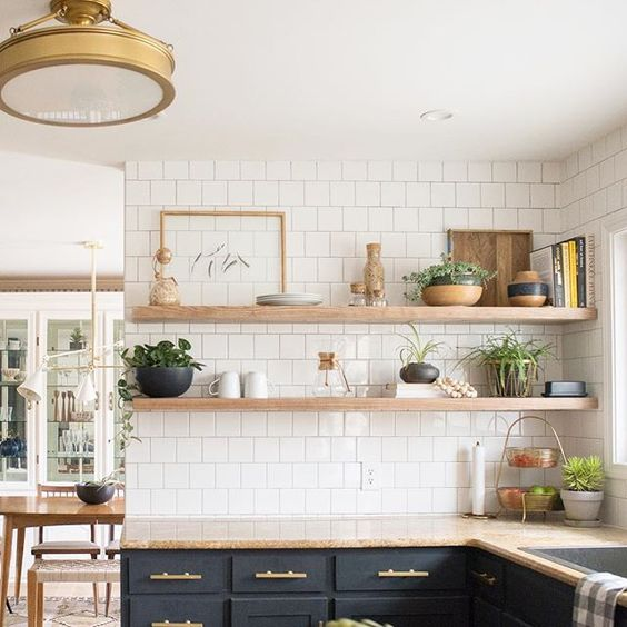 I'm thinking about rearranging the shelves. The lemon button fern isn't looking quite as full (what am I doing wrong?), so the right side of both shelves look a bit off. What do you guys think? Maybe go with more dishes and less stuff? #currenthomeview http://liketk.it/2q8fd @liketoknow.it #liketkit: