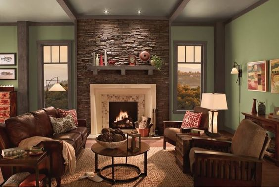 Olive green paint with stone accent wall..... Cream