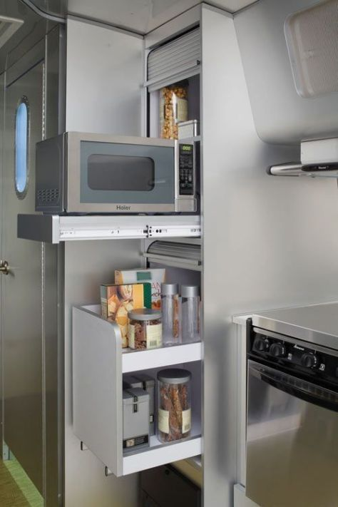 Great way to keep small appliances off of countertops. ---6 Organization Lessons to Learn from Tiny Houses | Apartment Therapy: