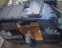 Great view of the Aluminess roof rack with solar panel on
