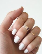 white nails knuckle rings