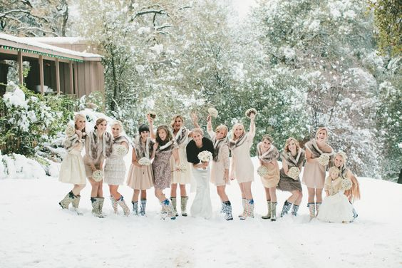 These bridesmaids are having a ball in their snow boots! | onelove photography:
