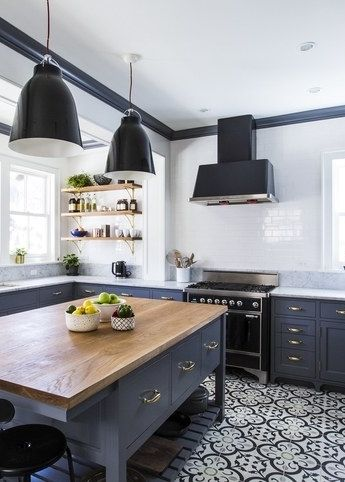 Custom tiles, a large island, and open shelves make for one chic kitchen.: