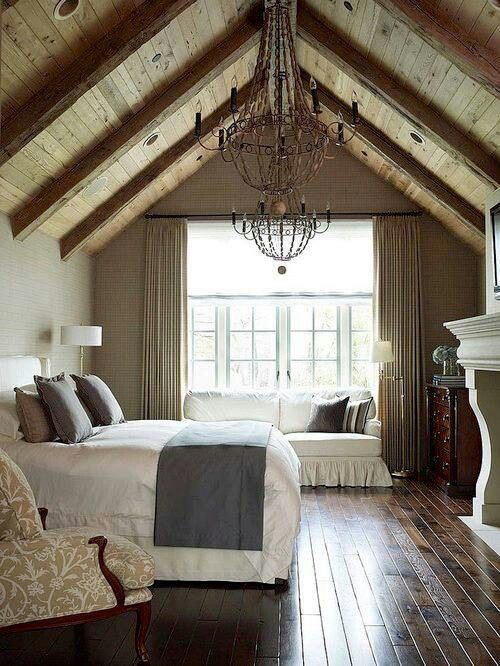 Love this #rustic attic bedroom with a dramatic a-frame ceiling.: