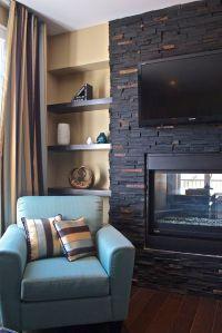 Interesting dark stone fireplace. The firebox and TV ...