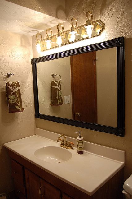 cheap interesting way to frame our a standard construction Bathroom mirror  not permanent so it