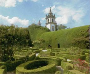 Vila Real, Casa de Mateus, Portugal. Formal garden layout with an arcade formed of cypresses
