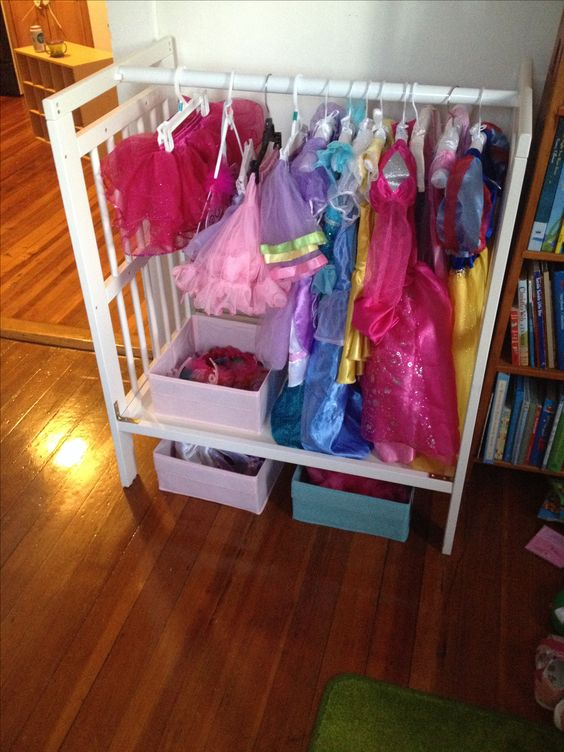 10 ways to repurpose a baby crib. Dress up station made from repurposed crib.