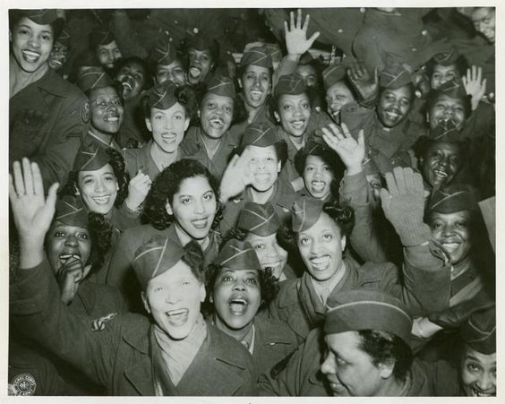 After almost fourteen months overseas in England and France the Wacs pictured above were happy to be home. They arrived from France on Friday, March 8th and landed at Staten Island Terminal of the New York Port of Embarkation. They were among the last contingent of the 6888th Central Postal Directory to return from overseas. 3/13/46. ~: