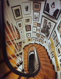 Matted and framed pictures on a spiral staircase. A ...
