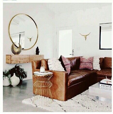 Living room - love the contemporary leather sectional, the oversized round mirror, and the natural wood floating entryway shelf/cabinet: