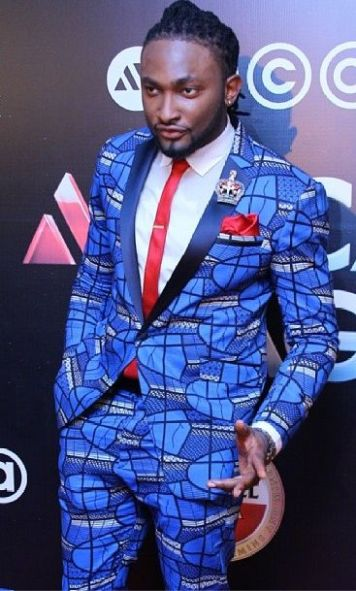 Image result for Uti Nwachukwu in colorful suits