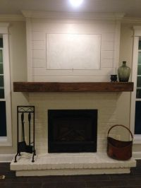 Painted brick, wood mantel and shiplap. Minus the hid
