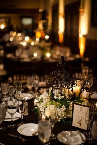 Reception table setting details - Black tablecloth, white ...
