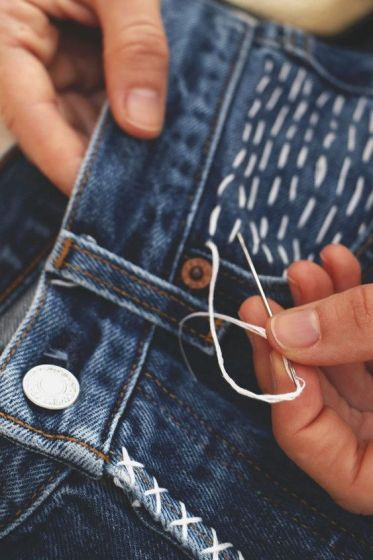 Add some simple stitches over the pocket for an extra touch. More: