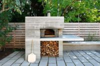 modern pizza oven w/ overhang work/prep/serving area ...