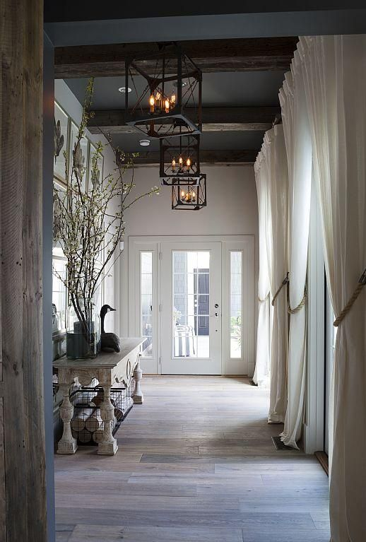 Elegant foyer entrance with 14' ceilings and French doors
