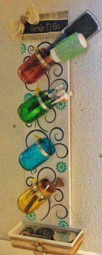 I love this mason jar bathroom rack! Hose clamps screwed ...