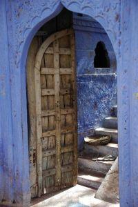 JAI Karauli in Rajasthan - wooden door on blue house with ...
