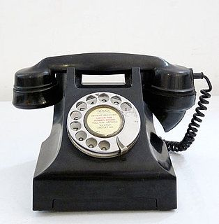 Classic Black Telephone back in the day the phone had two cords and came in any color as long as it was black: