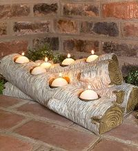 Artificial log candle-holder for inside the fireplace ...