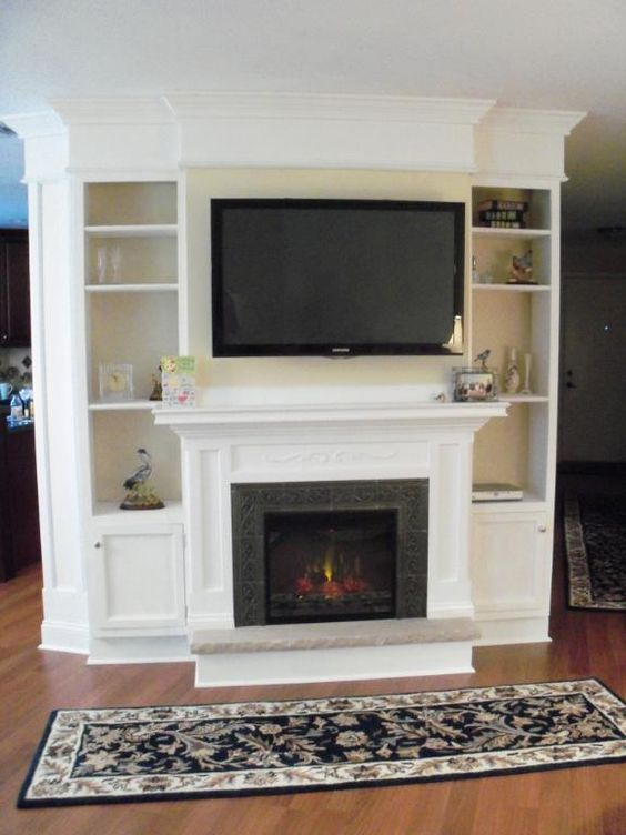 White fireplace with bookshelves  Bedroom fireplace ideas