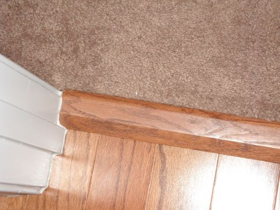 Where to place carpet to wood transition strip