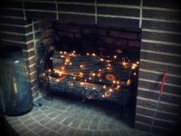 Add a string or two of twinkle lights in the fireplace to ...