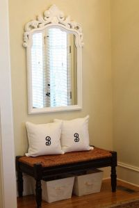 Entryway: small bench with cute pillows and storage tubs ...