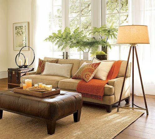 Beige and cream living room with rust red accents