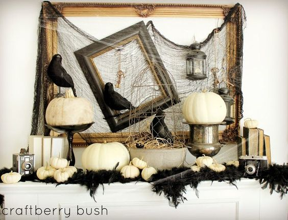 Black & White Halloween mantle decor. Gives kind of a vintage flair to the look.: