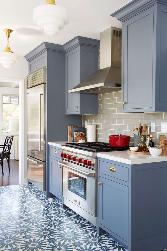 Benjamin Moore Wolf Gray a blue-grey painted kitchen cabinets with patterned floor tile and gray subway tile backsplash. Interior design by Ginny Macdonald for Emily Henderson.: