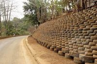 Tyre retaining wall | Recycled Tyres | Pinterest ...