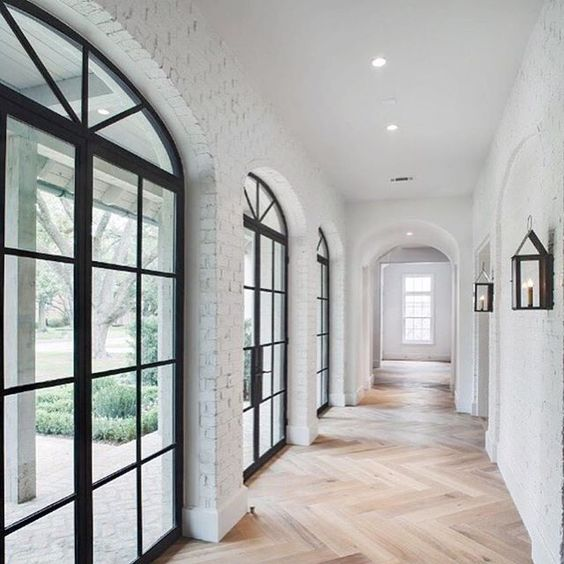 white brick on the interior...yes!! black windows, chevron floor, archways: