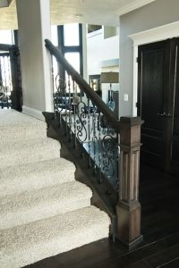 Wood and Metal railing with carpeted stairs | Stairways ...