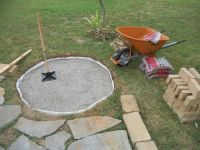 Fire pit 4 dig a hole, put sand, next crush gravel ...