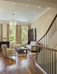 Tan living room walls, white trim and wood floors. Upper ...
