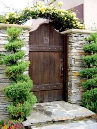 Awesome Wooden Gate Design Ideas with Stone Rock Wall and