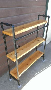 Bookcase made with steel pipe frame and solid wood shelves ...