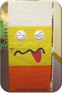 Candy corn, Halloween door and Monster classroom on Pinterest