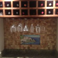 Wine cork backsplash. Nailed a piece of plywood to the ...
